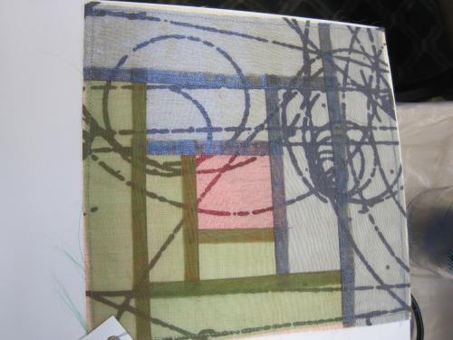 Meyer flat fell seam layered over silkscreen